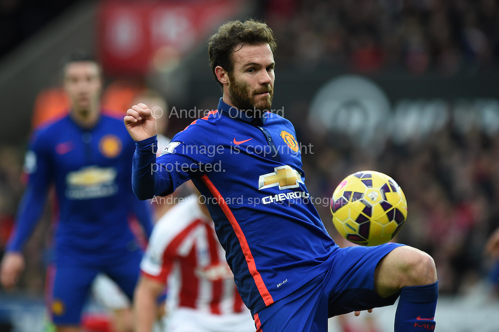 Juan Mata of Manchester Utd in action. Barclays Premier league match, Stoke city v Manchester Utd at the Britannia Stadium in Stoke on Trent, Staffs on New Years Day , Thursday 1st Jan 2015. pic by Andrew Orchard. Andrew Orchard sports photography.