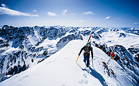 Greg Strokes and Adam Mozynski boot to the summit of Maroon Peak in order to ski the East Face and Bell Cord Couloir, Elks Range, Colorado.