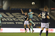 Millwall forward Tom Bradshaw  (9)  and Leicester City Defender Jonny Evans (6) battles for possession during the EFL Cup match between Millwall and Leicester City at The Den, London, England on 22 September 2021.