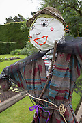 The face of an embroidered scarecrow in a garden at the Royal Botanical Gardens in Edinburgh, on 26th June 2019, in Edinburgh, Scotland. The Royal Botanic Garden Edinburgh RBGE is a scientific centre for the study of plants, their diversity and conservation, it was founded in 1670 as a physic garden to grow medicinal plants.