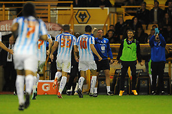 Huddersfield Town's Conor Coady celebrates his goal and his sides third goal making it 0 - 3 with the bench - Photo mandatory by-line: Dougie Allward/JMP - Mobile: 07966 386802 - 01/10/2014 - SPORT - Football - Wolverhampton - Molineux Stadium - Wolverhampton Wonderers v Huddersfield Town - Sky Bet Championship