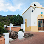 A small chapel in the town of Turrillas (Almeria, Andalucia, Spain) below a wind generator on Sierra de Alhamilla.