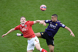 Bristol City's Matt Smith wins a high ball over West Ham's Winston Reid - Photo mandatory by-line: Alex James/JMP - Mobile: 07966 386802 - 25/01/2015 - SPORT - Football - Bristol - Ashton Gate - Bristol City v West Ham United - FA Cup Fourth Round