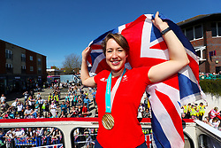Lizzy Yarnold holds a union jack flag during the victory bus tour through Sevenoaks, Kent.