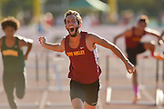 Simi Valley's Alex Billing screams as he crosses the finish line for a first place win in the 110-meter hurdles during the Ventura County Track and Field Championships on May 1, 2015 at Moorpark High School. Billing won with a time of 13.97 seconds.