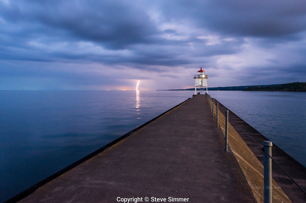 A quiet evening at the Two Harbors harbor entrance, untll I saw lightning on the horizon. This 30 second exposure captured the next bolt. Then, it was time to go, as thunder sounded directly overhead.