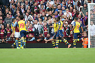Danny Welbeck of Arsenal (second right) celebrates scoring his side's second goal. Barclays Premier league match, Aston Villa v Arsenal at Villa Park in Birmingham on Saturday 20th Sept 2014<br /> pic by Mark Hawkins, Andrew Orchard sports photography.