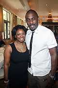24 June 2010- Miami Beach, Florida- l to r: Courtney Jones, Director, Public Affairs, Nielsen and Idris Elba at the The 2010 American Black Film Festival Founder's Brunch held at Emeril's on June 24, 2010. Photo Credit: Terrence Jennings/Sipa