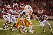 Nov 12, 2011; Fayetteville, AR, USA;  Tennessee Volunteers tailback Devrin Young (19) carries the ball as tailback Reggie Juin (22) blocks and Arkansas Razorbacks cornerback Isaac Madison (6) looks for the tackle during a game at Donald W. Reynolds Razorback Stadium. Arkansas defeated Tennessee 49-7. Mandatory Credit: Beth Hall-US PRESSWIRE