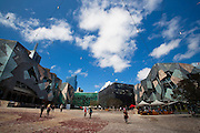 Federation Square, Melbourne. On the left is the Arthur Deaking Building. The green building centre is The Atrium. Editorial use only.