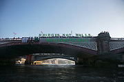 Banners were dropped on bridges crossing the Thames in protest against the inauguration of Donald Trump, January 21st 2017 in London.  A banner on Blackfriars Bridge. On Friday 20th January over 50 groups across the United Kingdom dropped banners from bridges as an act of defiance against Trump's inauguration. The groups, who form the 'Bridges not Walls' movement, staged their demonstration to show support for people in the USA and beyond fearing the consequences of Trump's election. <br /> <br /> In London ten iconic bridges on the Thames saw huge banners 25m long unfurled on them.