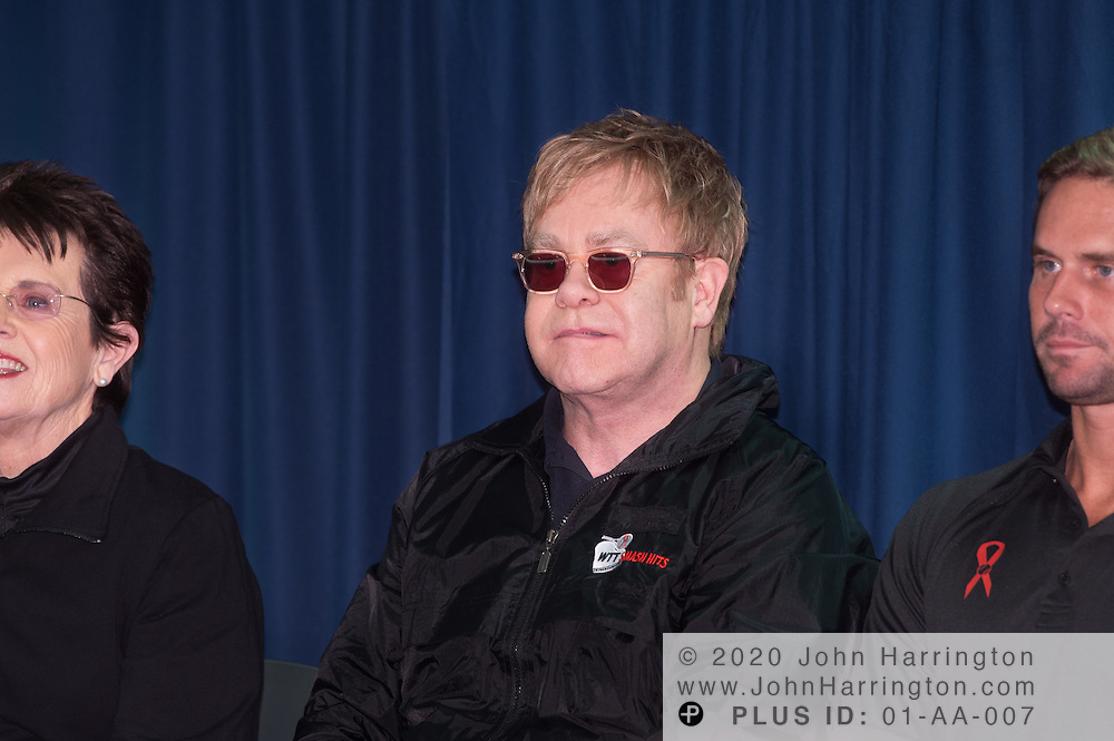 Sir Elton John (center) speaks at the 2010 WTT Smash Hits charity event with Billie Jean King (left) and Jan-Michael Gambill (right) sitting next to him. The event drew several of the top names in tennis to come together to raise money for the Elton John AIDS Foundation and the Washington AIDS Partnership at American University on November 15th, 2010.