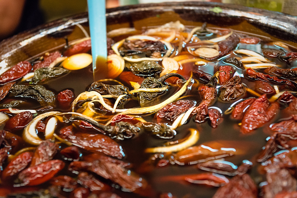 Pot of chilli soup boiling at a market stall in Cholula, Mexico