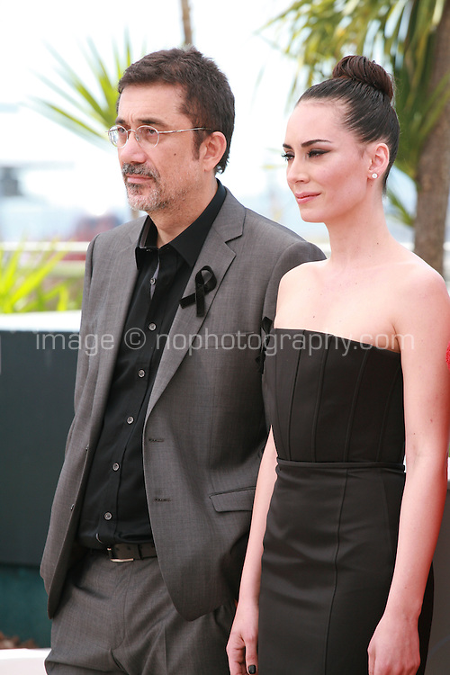 Nuri Bilge Ceylan and Melisa Sözen at the photocall for the film Winter Sleep (Palme d'Or winner) at the 67th Cannes Film Festival, Friday 16th May 2014, Cannes, France