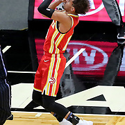 ORLANDO, FL - MARCH 03: Trae Young #11 of the Atlanta Hawks attempts a shot against the Orlando Magic during the first half at Amway Center on March 3, 2021 in Orlando, Florida. NOTE TO USER: User expressly acknowledges and agrees that, by downloading and or using this photograph, User is consenting to the terms and conditions of the Getty Images License Agreement. (Photo by Alex Menendez/Getty Images)*** Local Caption *** Trae Young