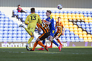 Hull City goalkeeper Matt Ingram (13) clearing ball from AFC Wimbledon midfielder Jack Rudoni (12) during the EFL Sky Bet League 1 match between AFC Wimbledon and Hull City at Plough Lane, London, United Kingdom on 27 February 2021.
