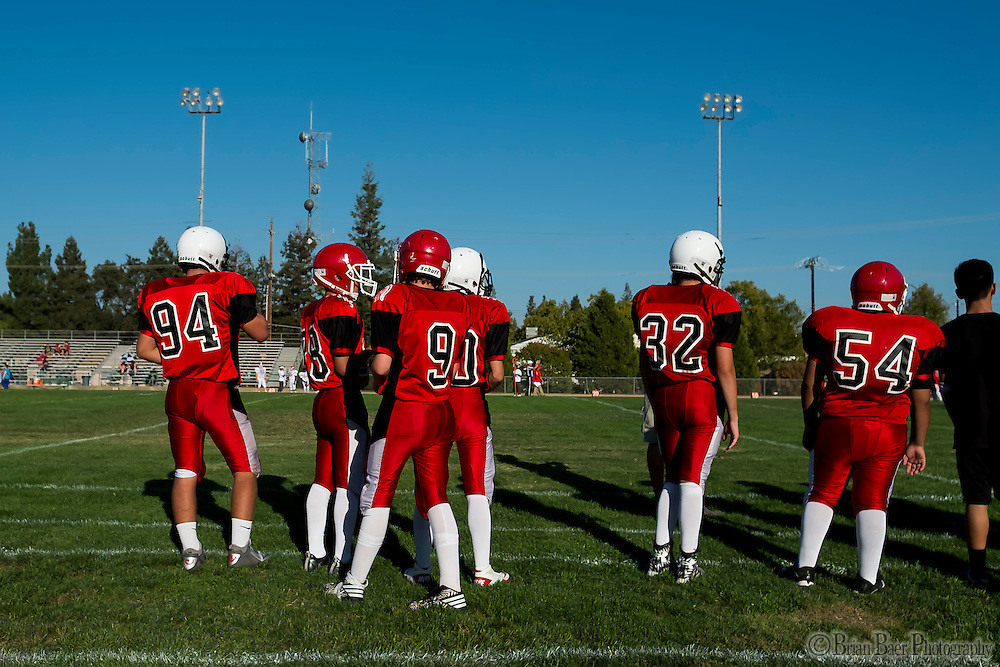 The small San Juan Spartans JV team wears different colored helmets as they host the Mira Loma Matadors, Friday Sep 16, 2016. The Varsity coaches also coach the JV team in this small program.<br /> photo by Brian Baer