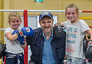 NO FEE PICTURES<br /> 22/7/18 Actor Liam Neeson, who is currently fliming in Northern Ireland, stopped by O'Hanlon Park Amateur Boxing Club, Dundalk today, much to the surprise and delight of local community members. The Club/Community Hall is open to members of the community of all ages - children from seven years of age right through to adults who have reached retirement age. Neeson is a long time friend of Hotelier John Fitzpatrick who has been involved with the boxing club since 2011 when he made a donation to the Club when he participated in The Secret Millionaire show which aired on RTE 1.   Following the broadcast of the programme, John helped raise more than €425,000 through the Eithne & Paddy Fitzpatrick Memorial Fund and the Boxing Club raised over €56,000 including a grant, to enable the Club move to the new building. Pictured: Liam Neeson with local girls Kayla McAreavey  and her friend Alisha Picture:Arthur Carron
