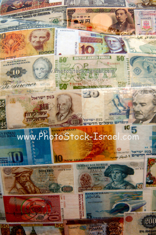 A collection of paper notes from different countries and currencies