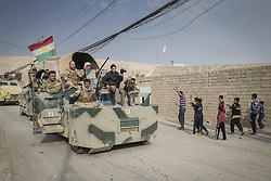 October 27, 2016 - Fadiliyah, Ninewah, Iraq - People celebrate in the town of Fadiliyah as Kurdish Peshmerga forces have liberated Fadiliyah from ISIS. (Credit Image: © Bertalan Feher via ZUMA Wire)