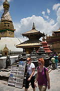 Western tourists at the Swayambhunath temple complex, also called the Monkey Temple.