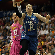 Lindsay Whalen, Minnesota Lynx, drives to the basket past Katie Douglas, Connecticut Sun, during the Connecticut Sun Vs Minnesota Lynx, WNBA regular season game at Mohegan Sun Arena, Uncasville, Connecticut, USA. 27th July 2014. Photo Tim Clayton