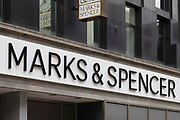 A sign for a branch of large British multinational retail brand Marks & Spencer on 28th July, 2021 in Leeds, United Kingdom. Marks & Spencer is a major British retailer headquartered in London and founded in Leeds in 1884.