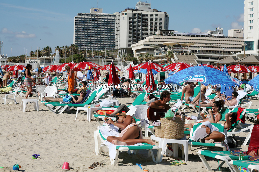 File Photos - Brits likely to risk health this summer - report<br /> A survey by Cancer Research UK and Nivea Sun, embargoed until April 29, suggests that around 4.9m in the UK, or 10% of the population, are likely to risk scorching themselves in strong sun in an attempt to get a tan following recent cold and wet weather. The survey also reveals that 44% of those planning to holiday abroad are doing so because of the UK's poor weather.<br /> <br /> People sunbathing on the beach in Tel Aviv, Israel, May 1st, 2008, Photo By Andrew Parsons / i-Images