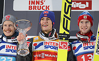 INNSBRUCK,AUSTRIA,04.JAN.17 - NORDIC SKIING, SKI JUMPING - FIS World Cup, Four Hills Tournament, large hill, award ceremony. Image shows Robert Johansson (NOR), Daniel Andre Tande (NOR) and Evgeniy Klimov (RUS). <br /> <br /> Norway only
