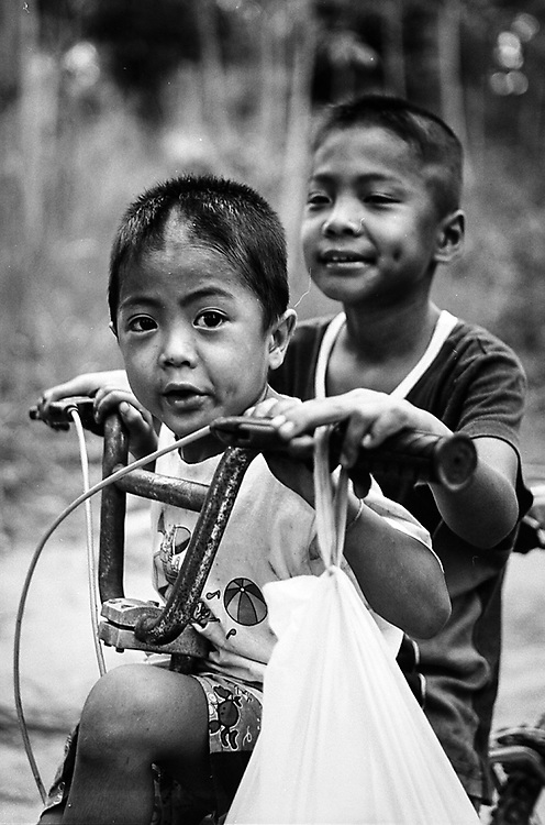 Ranong, Thailand. Two young Burmese refugee are posing for a portrait. Photo by Lorenz Berna