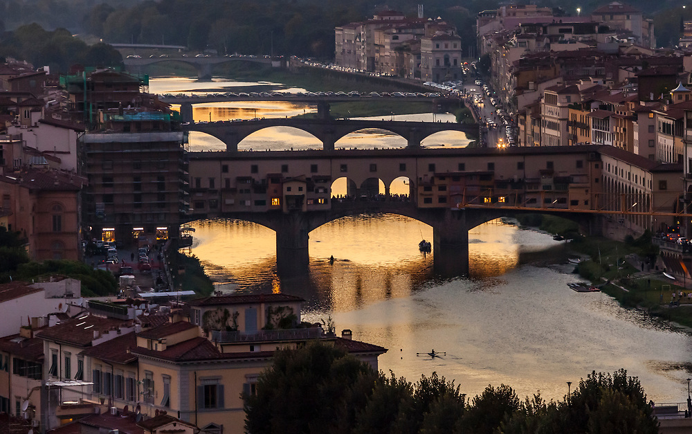 A view looking West at sunset from Piazzale Michelangelo, Florence, Italy. This is the famous Ponte Vecchio bridge over the Arno river