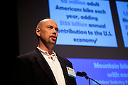 """Expert Presentation by Philip Kiracofe, Chief Adventurist, Horizon Partners, """"Mountain Bike Ayati: The Bike as an Economic Driver,"""" during the Manhattan Chamber of Commerce's Transportation Transformation Global Summit at NYIT in New York on April 26, 2012."""