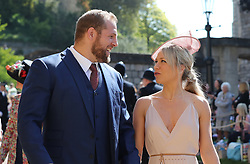 James Haskell and Chloe Madeley arrive at St George's Chapel at Windsor Castle for the wedding of Meghan Markle and Prince Harry.