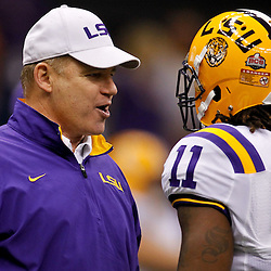 Jan 9, 2012; New Orleans, LA, USA; LSU Tigers head coach Les Miles talks with LSU Tigers running back Spencer Ware (11) before the 2012 BCS National Championship game against the Alabama Crimson Tide at the Mercedes-Benz Superdome.  Mandatory Credit: Derick E. Hingle-US PRESSWIRE