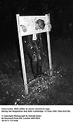 Gatecrasher, Rob Collins in stocks covered in eggs during the Magdalene May Ball. Cambridge. 15 June 1983. Film 83415f6.<br /> © Copyright Photograph by Dafydd Jones<br /> 66 Stockwell Park Rd. London SW9 0DA<br /> Tel 0171 733 0108