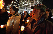 Ken Kohler screams in support during the Keeping Families Together Candlelight Vigil held near Temple Square. The event, put on by the Salt Lake Dream Team, sought to remember families separated by immigration raids, deportations and a flawed immigration system, Wednesday, Dec. 12, 2012.
