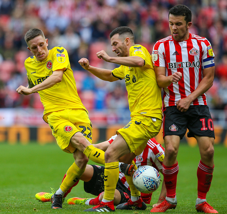 Fleetwood Town's Ashley Hunter and Jason Holt battles with Sunderland's George Honeyman and DylanMcGeouch<br /> <br /> Photographer Alex Dodd/CameraSport<br /> <br /> The EFL Sky Bet League One - Sunderland v Fleetwood Town - Saturday September 8th 2018 - Stadium of Light - Sunderland<br /> <br /> World Copyright © 2018 CameraSport. All rights reserved. 43 Linden Ave. Countesthorpe. Leicester. England. LE8 5PG - Tel: +44 (0) 116 277 4147 - admin@camerasport.com - www.camerasport.com