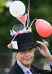 © licensed to London News Pictures. 14/06/2011. Ascot, UK.  David Shilling arriving on day one at Royal Ascot races today (14/03/2011). The 5 day showcase event,  one of the highlights of the racing calendar is in it's 300th year. Horse racing has been held at the famous Berkshire course since 1711 and tradition is a hallmark of the meeting. Top hats and tails remain compulsory in parts of the course. Photo credit should read: Ben Cawthra/LNP