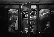 Commuter on Southern region train delayed in Charing Cross station. Coming and Going is a project commissioned by the Museum of London for photographer Barry Lewis in 1976 to document the transport system as it is used by passengers and commuters using public transport by trains, tubes and buses in London, UK.