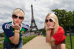 PARIS, FRANCE - Saturday, June 25, 2016: Northern Ireland supporter Diane Boswell and Wales supporter Georgia Milton blow a kiss to the camera by the Eiffel Tower, Paris, ahead of the Round of 16 UEFA Euro 2016 Championship match at the Parc des Princes. (Pic by Paul Greenwood/Propaganda)