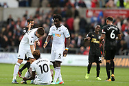 a dejected Tammy Abraham of Swansea city (10) is helped up to his feet by teammates  Wilfried Bony and Federico Fernandez at the final whistle. Stadium in Swansea, South Wales on Sunday 10th September 2017.<br /> pic by  Andrew Orchard, Andrew Orchard sports photography.