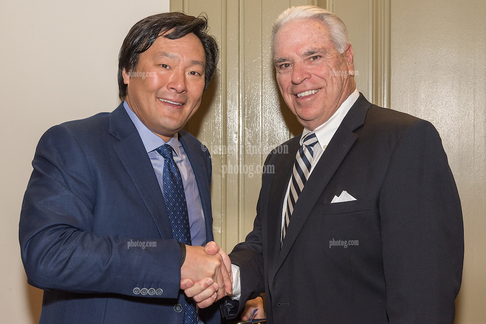 Yale Athletics Director Thomas A Beckett presenting the 2016 Kiphuth Fellowship Medal to recipient Ming Tsai '86. Yale University Athletics. New Haven Connecticut 23 February 2016.
