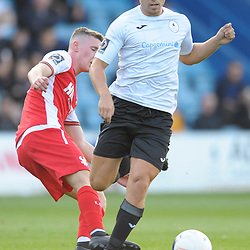 TELFORD COPYRIGHT MIKE SHERIDAN Adam Walker takes on Alex Prosser during the National League North fixture between AFC Telford United and Kidderminster Harriers on Tuesday, August 6, 2019.<br /> <br /> Picture credit: Mike Sheridan<br /> <br /> MS201920-006