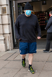 © Licensed to London News Pictures. 10/04/2021. London, UK. British Prime Minister BORIS JOHNSON is seen leaving a branch of Marks and Spencers in central London whilst out exercising. Photo credit: London News Pictures