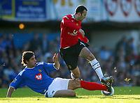 Fotball<br /> Premier League England 2004/2005<br /> Foto: BPI/Digitalsport<br /> NORWAY ONLY<br /> <br /> 30.10.2004<br /> Portsmouth v Manchester United<br /> <br /> Ryan Giggs of Man Utd is tackled by Dejan Stefanovic