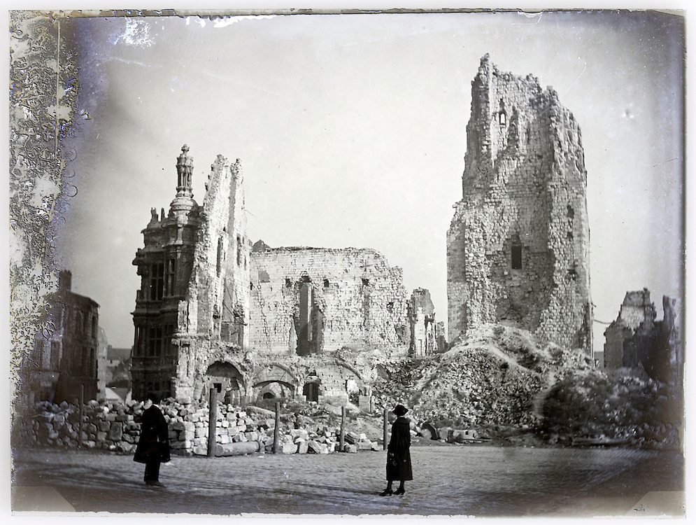 people looking at a church ruin