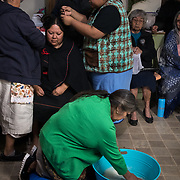 Hours before the sun came up on the fifth day (March 23, 2019), Sarah Honanie, in the green sweater, mixes yucca root with water, while Gloria Phillips (top left) takes Kars's hair down. When yucca root is mixed with water it turns into a natural shampoo. The couples' hair was washed, then it was intertwined and washed together, bonding them in marriage and signifying their union as husband and wife.