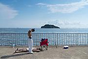 fishing on a hot summer day at Umikaze park, Yokosuka with Tokyo Bay and Sarushima Island