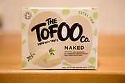 Close up packet of organic Tofu advertised as Naked from the Tofoo company, UK