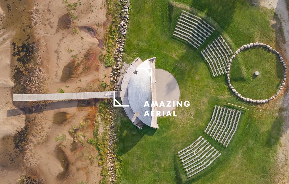 Aerial view of outdoor amphitheater near a village, Estonia.